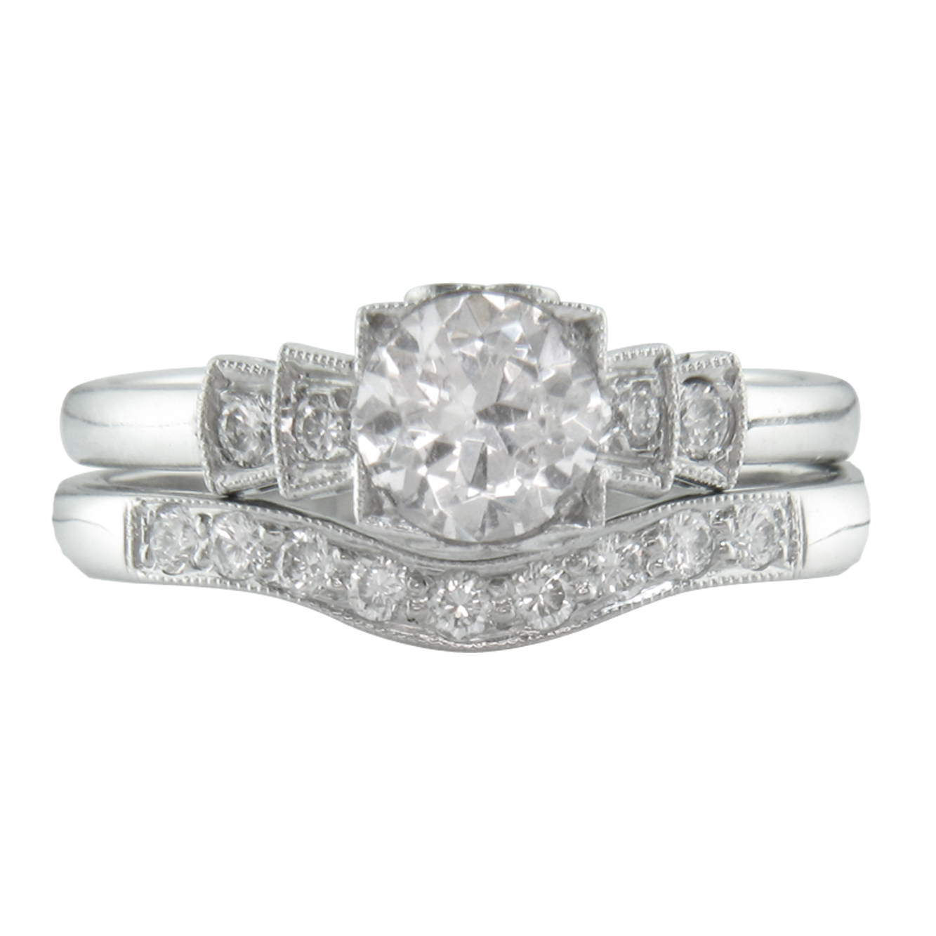 1930s Style Engagement Ring with Heart Motif in White Gold, £2,080 & Curved Diamond Wedding Ring, £735 www.london-victorian-ring.com
